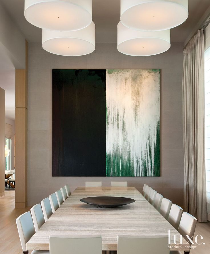 Whether it's a painting, a series of photographs or a sculptural piece, this collection of rooms demonstrates prime uses for oversized art.
