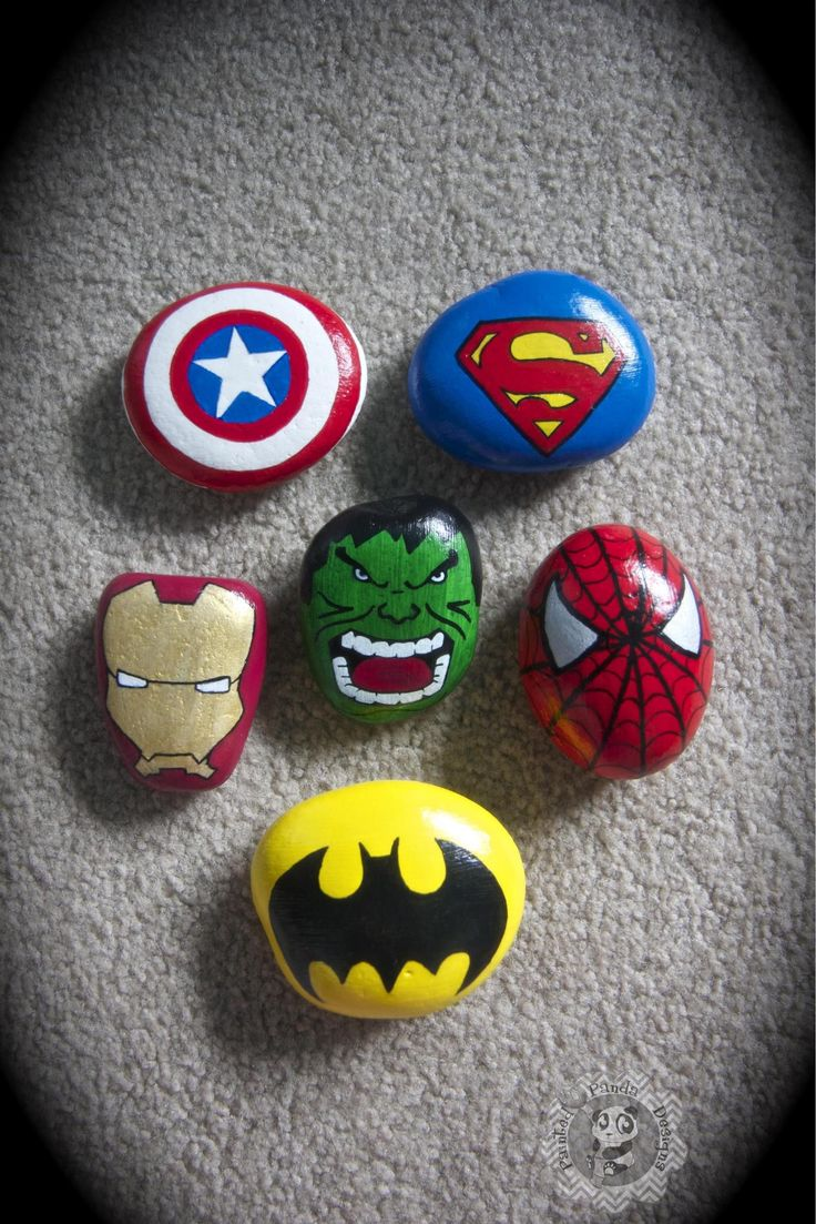 Hero painted rocks . Captain america ,batman spiderman ,superman , the hulk & iron man. Facebook.com/PaintedPandaDesigns