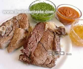 Boiled meat accompanied by a lot of cold sauces