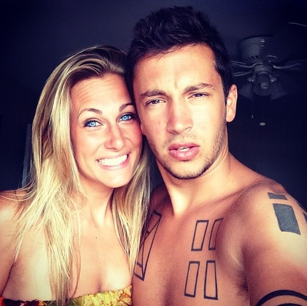 Tyler Joseph from twenty one pilots with his girlfriend Jenna black