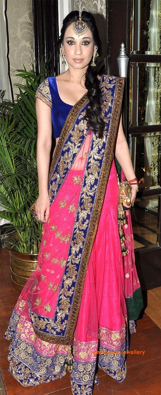 Maang tikka. Blue velvet and pink lehnga by Manish Malhotra