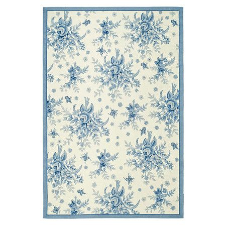 Hand-hooked wool rug in ivory and blue with a rose bouquet motif.  Product: RugConstruction Material: Wool