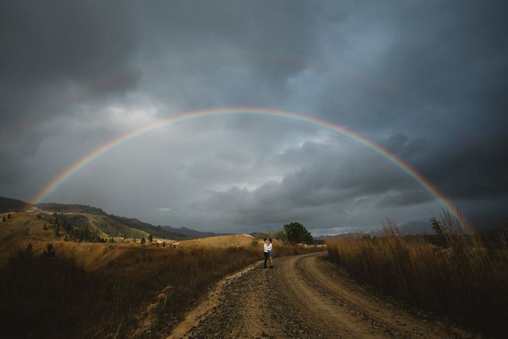 It was the perfect double rainbow and also a perfect engagement photo for this couple.