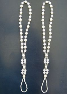 The beaded barefoot sandals, when completed, look a bit like necklaces