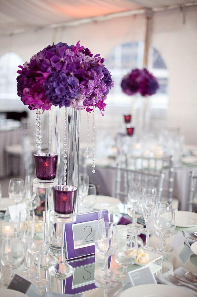 purple hydrangeas; flora centrepieces; purple candle holders
