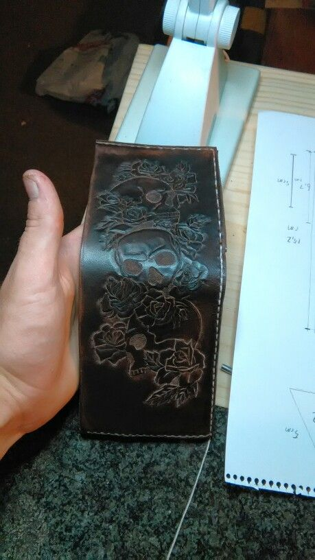 Leathercrafting at its best busy stitching this leather wallet by hand