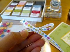 One of the nicest ways to finish off a card is with a ribbon bow. I thought I was pretty good at tying ribbon, but I found that without a c...
