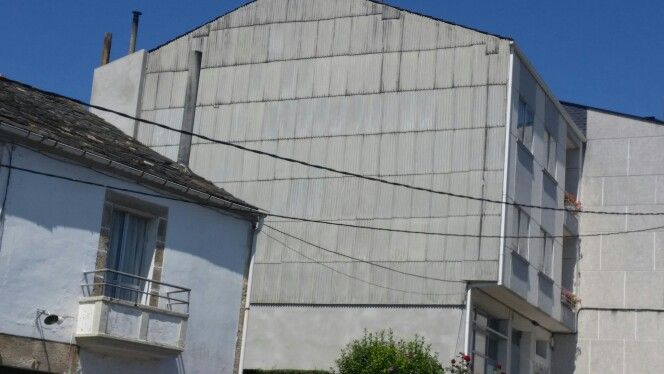 Asbestos Cement wall cladding. The flue is also made of asbestos Cement. Melide Galicia Espana