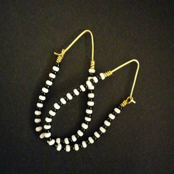 Very, very light. Unique shape. Earrings hang 6 cm or 2.4 inches from your piercing. 2.5 cm or 1 inch at widest point across the earring. Unique shape, classic black and white combo adds a classic flair to your look. Brass earring hooks. Will arrive at your doorstep