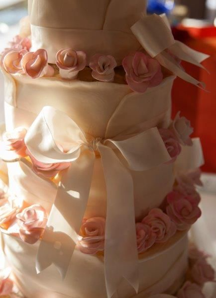 Tastiest wedding cake! Divine layers of lychee rose and caramelised date and fig, all encased in a creamy white chocolate buttercream
