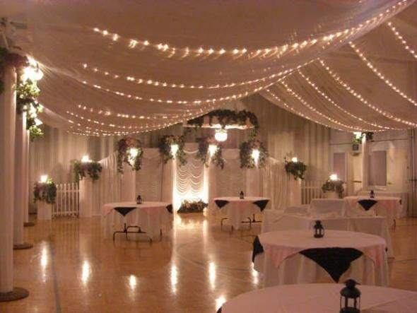 gossamer and lighted ceilings with tulle lined walls reception hallwedding