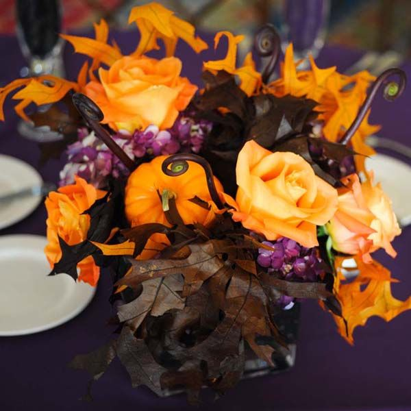 Orange, Brown, And Purple Centerpieces    A mini pumpkin perfectly complements the orange roses, brown leaves, and purple hydrangeas.