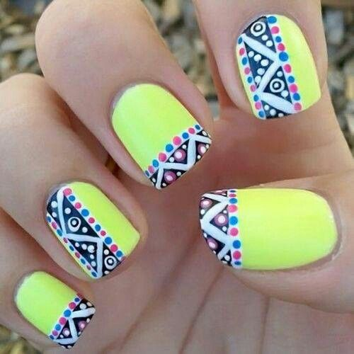 Bright yellow nails w/ tribal design