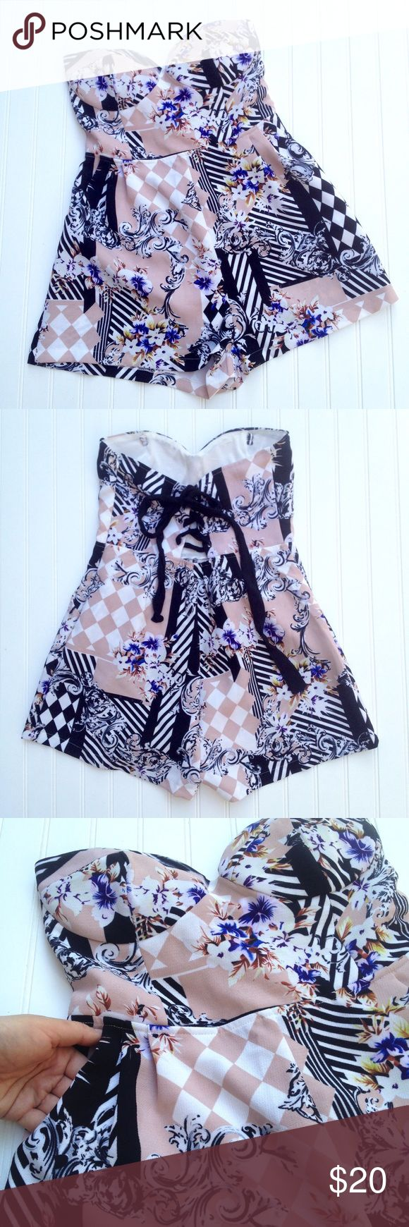 """Floral and checked strapless corset back romper Sexy strapless romper from Ally Fashion Australia has a blush pink background overlaid with white, purple and brown florals and black and white checks and stripes. Sweetheart neckline has lightly lined cups (no underwire) and corset lace-up back. Invisible side zipper. AU size 12 is equivalent to US size 8. Bust: approx. 15"""" (adjustable with back) Waist: 14.5"""" Length: 24"""". VGUC--has a slight run at bottom of back right leg. See last pic for…"""