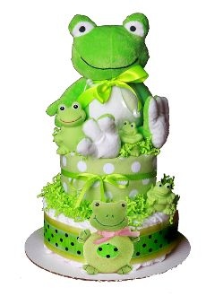 """Leap Frog ($69.95)- Froggy diaper cake is filled with 40 diapers, blanket, 3 bath frogs, plush frog rattle, topped off with an 8"""" tall  plush frog. He is green with envy over the new baby to arrive. A unique baby shower gift and so much fun for baby.  This diaper cake sits on a 10""""  cake board and is 16"""" in height. Comes wrapped in white tulle netting with coordinating ribbons and bows.   Choose from baby blue or baby pink frog rattle"""