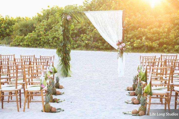 Postcard Inn, St Pete Beach FL, Tropical Beach Wedding, Boho Wedding, Beach Ceremony, Arch, Gold Chiavari Chairs, Pineapple aisle decor, Lifelong Studios Photography, Iza's Flowers
