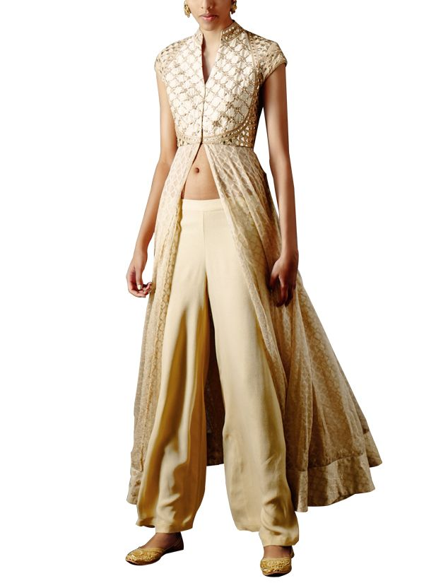 Make a statement this festive season in this striking Anita Dongre set that includes a jacket style kurta, a pair of pants and a dupatta. The jacket features a front slit that enhances its flare. Exquisite gota-patti embroidery across the yoke is the highlight of the jacket. It is paired with pants and a net dupatta that give the outfit a truly fusion appeal. #anitadongre #indiandesigers #indianclothes #contemporaryindianclothes #strandofsilk