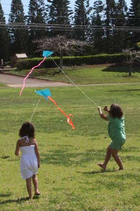 These are the kites we made last year for M's b-day party.  So easy to complete with materials at home, and kids can decorate the papers with stickers, drawings, etc.  And they fly really well!  It's the truth.  And it's EASY!