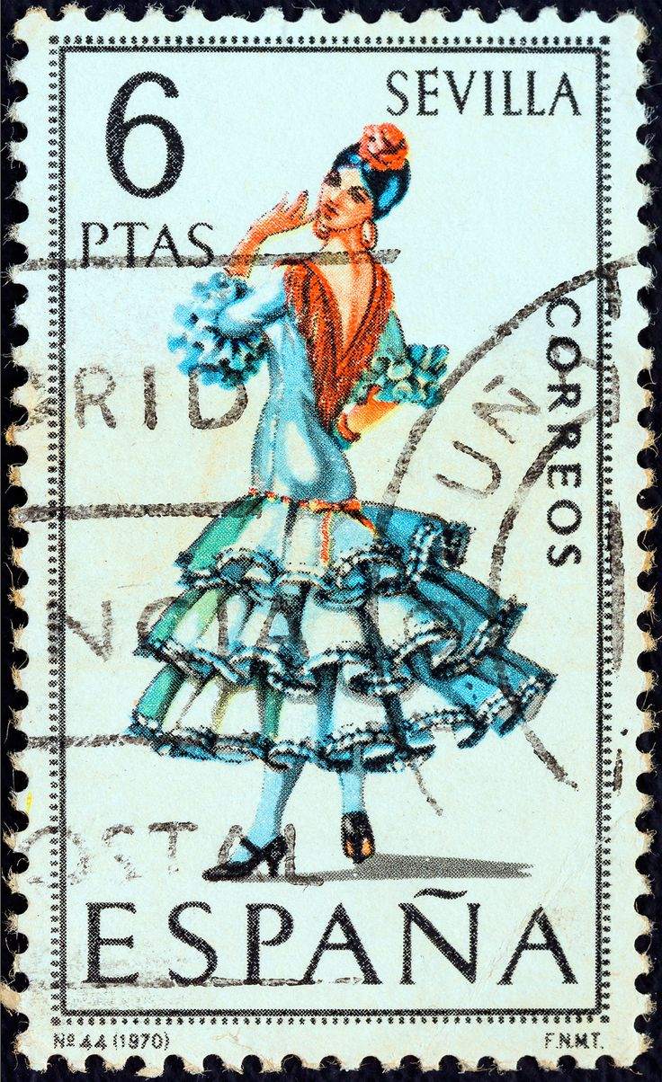 """SPAIN - CIRCA 1970: A stamp printed in Spain from the """"Provincial Costumes"""" issue shows a woman from Seville, circa 1970."""