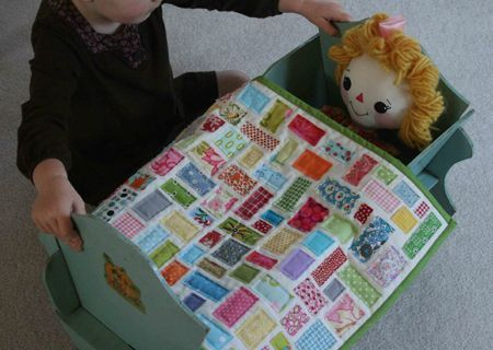When I first saw this doll quilt, I thought it looked fussy, but it was one of the most fun and addictive projects ever! I used one fat quarter for the back, and white flannel for the front, to eliminate the trouble of stitching through batting. The finished quilt is the perfect size and weight for playing with.