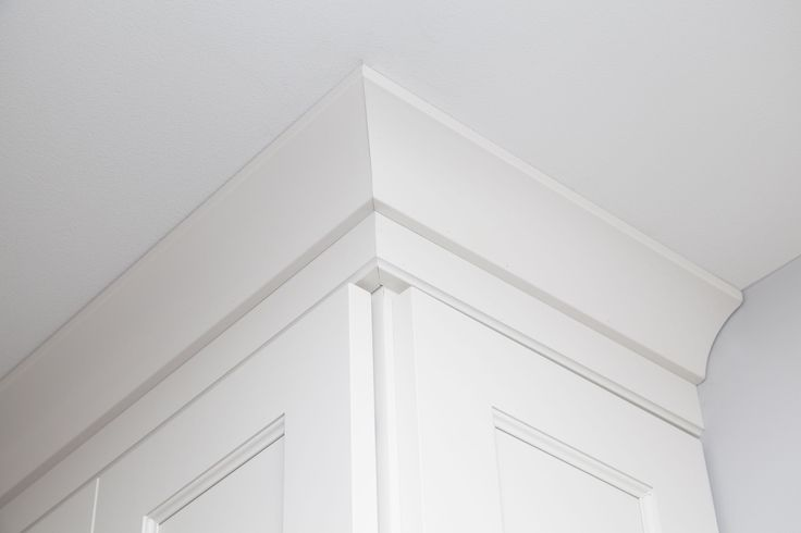 This is a crown molding detail.  We used a simple crown molding with a small detail below for a classic look. #details #kitchen #molding