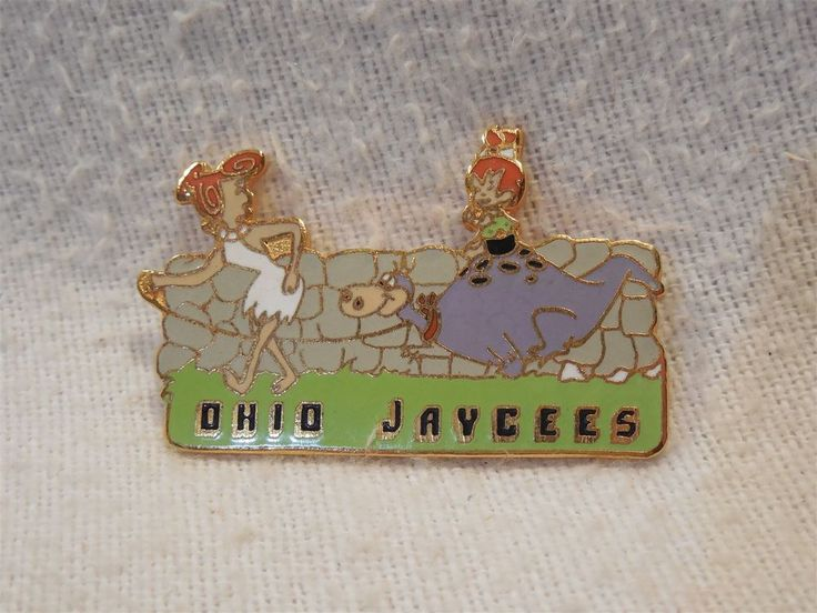 This is a Flintstones Ohio Jaycees metal lapel pin. The pin pictures Wilma Flintstones walking Dino on a leash.Pebbles is riding on Dino's back. There is a locking pin clasp on the back. | eBay!
