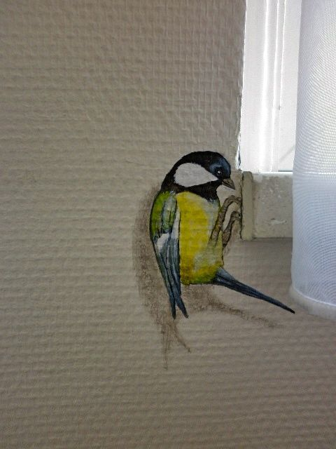 This little bird makes such a cute hand painted detail for any room.  #mural #funmural