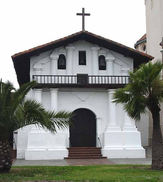 Mission Dolores in San Francisco, near where Natalie lives. She compares the big rounded doors of this mission to the narrow wooden doors of the Carmelite abbey in Paris. #amwriting #thriller