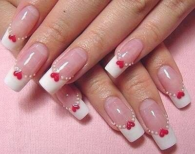 White tips with red heart nail design