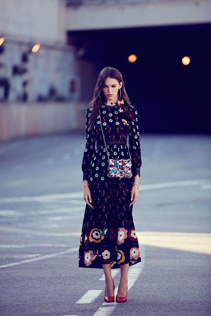 Looking ladylike, the model wears RED Valentino dress, Mango earrings, Jimmy Choo bag, Chanel bracelet and Louis Vuitton heels
