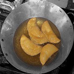 FILIPINO VIGAN EMPANADA RECIPE = INGREDIENTS = CASING 1 1/2 cup Mochiko Rice Flour Orange food coloring (optional) 1/2 cup Water 1 tbsp. Oil  FILLING: 1 Green UN-Ripe Papaya (grated) 4 pcs. Longganisa Sausage Chopped (remove from its casing) 1/2 Chopped Onion 1 Garlic Clove Finely Chopped 6 Eggs Salt Pepper ====