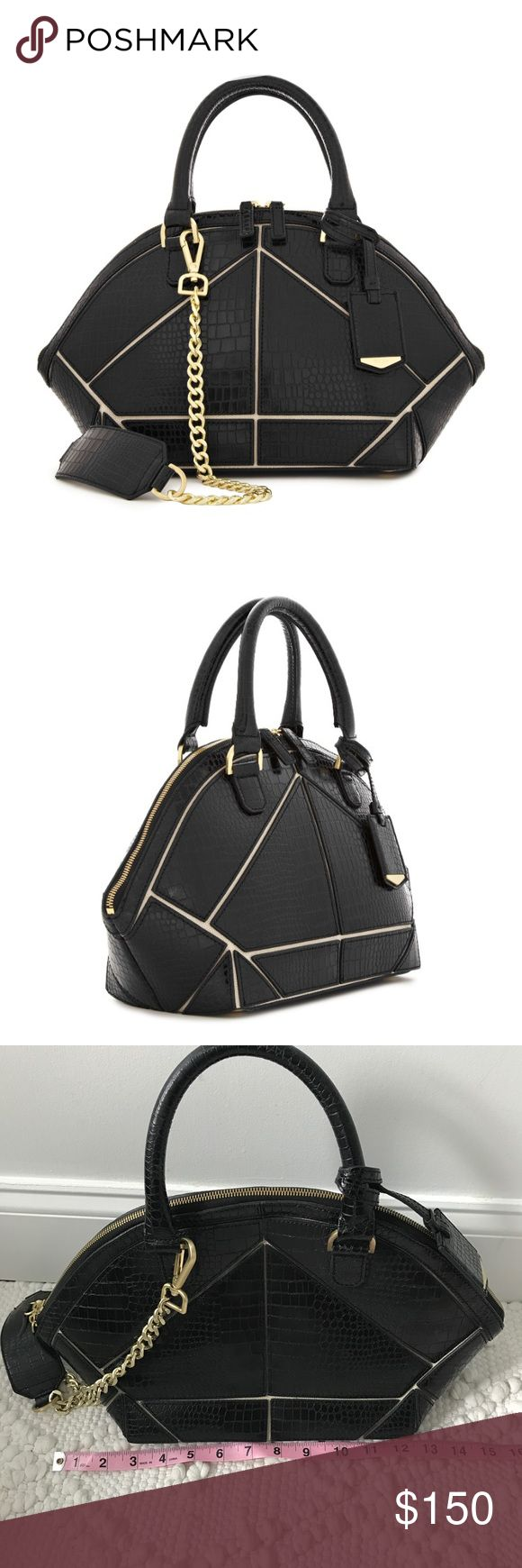 Reiss Fia Black Leather Tote Bag Satchel Zip Up Fia in black moc croc leather is a short handle bowling bag. In panelled moc croc over contrasting canvas, this retro-inspired shape has a modern touch: d-ring straps, a zip across top, gold studs to the base and a detachable chain strap with shoulder guard. Inside it is fully lined and has two pouches and one zip pocket. This Handbag is in excellent preowned condition. It has small signs of wear on the bottom on the gold hardware and on the…