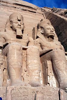 Ancient Egypt - Four colossal statues of Ramesses II flank the entrance of his temple Abu Simbel.