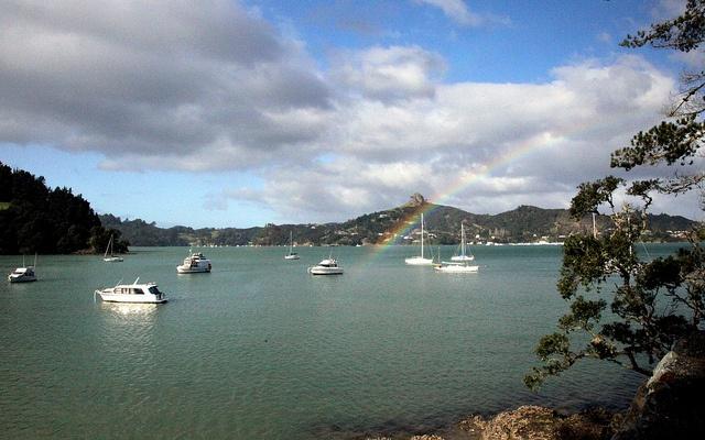 Rainbow over St.Pauls  St. Pauls rock is the distinctive nipple shaped volcanic plug behind the township Of Whangaroa. The photo is taken across Whangaroa Harbour from Totara north
