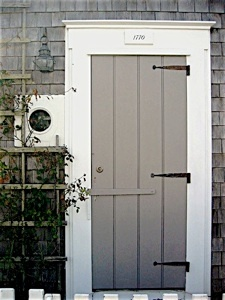 perfect gray batten door with nautical porthole detail