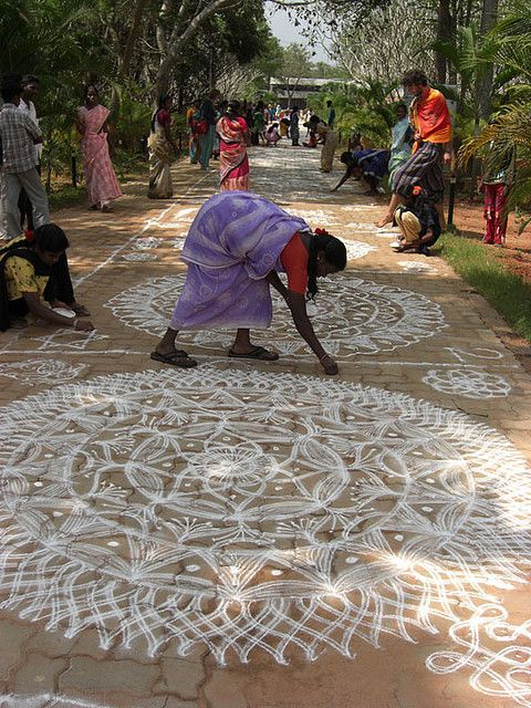 "The kolam, or ""rangoli"" is a traditional mandala, a geometric pattern, that women design in front of their houses during festivities. In Tamil culture is a strong form of expression by the women, who express their feelings in this secret way."
