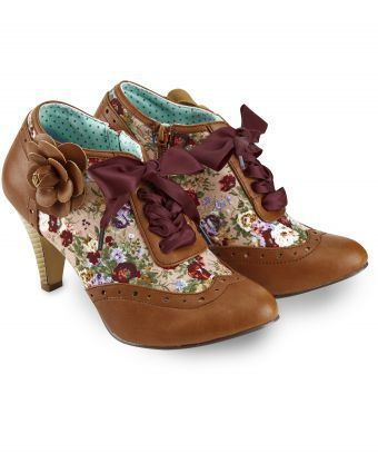 Quirky and individual, these pretty shoe boots look great with your favourite jeans. The floral inserts, ribbon lacing and a lovely decorative corsage make these one of our favourites for the season. Heel height: 8cm