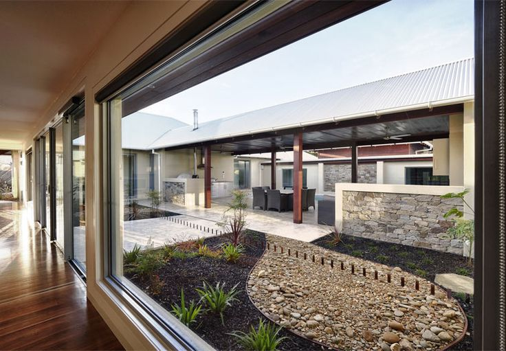 Rylock Windows and Doors www.rylock.com.au Sliding doors integrate with SuperLite windows to bring together interior living areas & the outdoor atrium. The doors also take full advantage of cool cross breezes, whilst electronically operated awning windows vent warm ceiling air to the atmosphere. All products are double glazed for thermal comfort. The Rylock Metallic Silver powder coated frames create a strong contrast with the natural tones & textures of raw timber & stone.