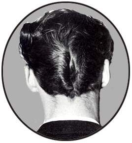 Also called the D.A. or duck butt, the style requires that you comb the hair back to the middle of the head, then with the end of a rattail comb, make a center part.  Although the ducktail was adopted lovingly by Hollywood to represent the wild youth of the Fifties, the fact is that only a small minority of guys actually sported a D.A.