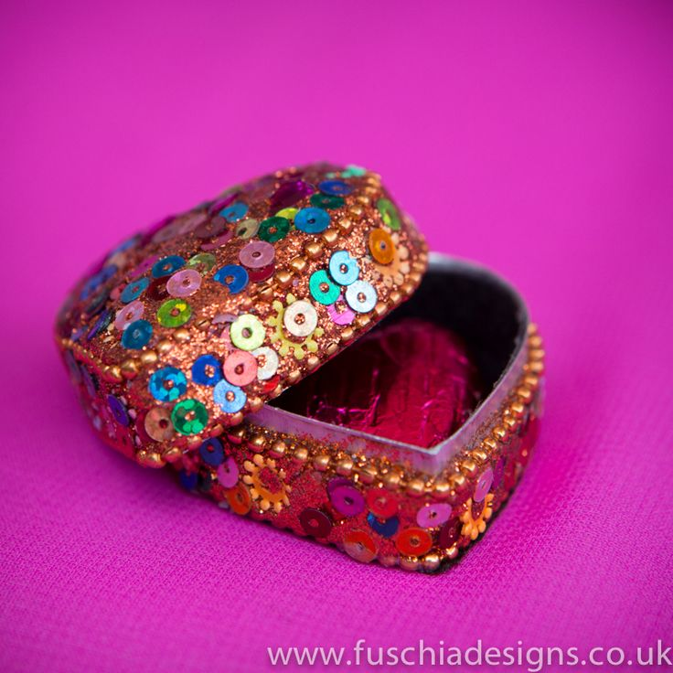 Beautiful and colourful these sequinned Asian trinket pots are just perfect for Asian Wedding and Celebration Asian favours.  A milk chocolate heart fits inside.  Also great for mehendi celebrations from www.fuschiadesigns.co.uk