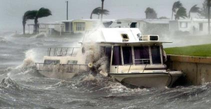 Hurricane Frances batters a boat that broke away from its anchor