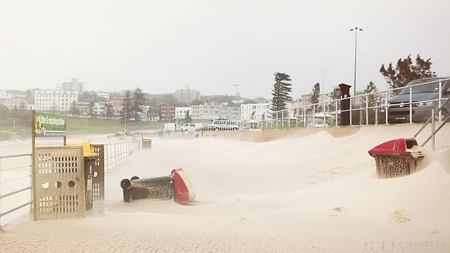 Bondi's beach sand blanketed most of its world famous sidewalk as a result of the weather
