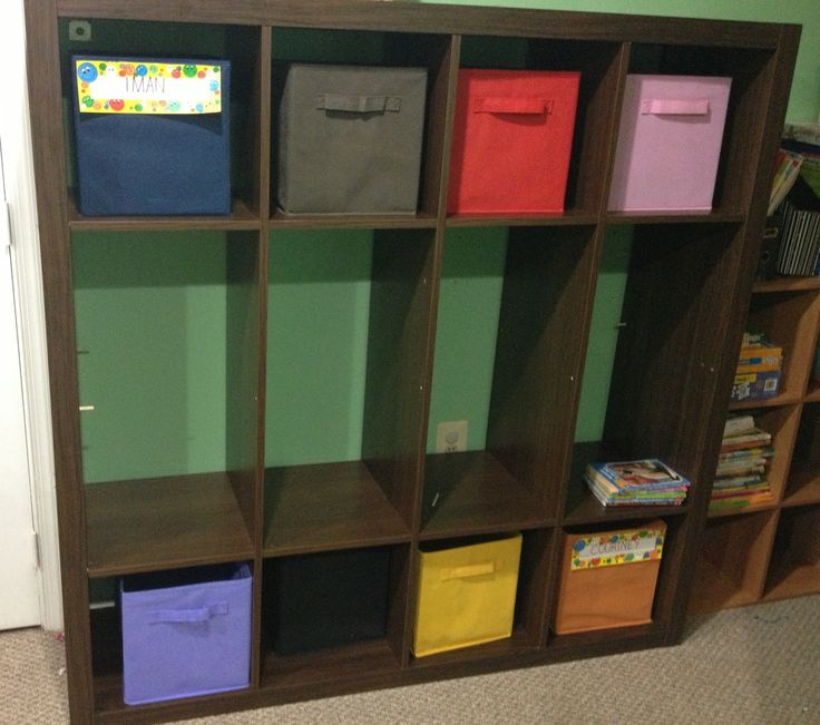 By removing some shelves, I transformed my Ikea Expedit bookcase into a cubby hole/ coat rack for my daycare children.