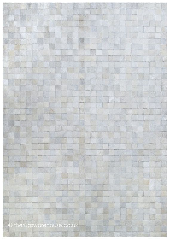 Calibra Rug, a handmade patchwork cowhide leather rug in shades of light beige, silver & white (handmade in Spain, 6 set + custom sizes) http://www.therugswarehouse.co.uk/calibra-rug.html #rugs #interiors