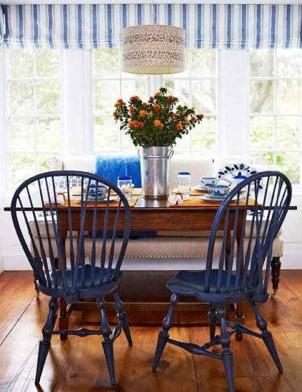 Windsor chairs painted navy blue are a fun addition to this blue-and-white breakfast nook. - Traditional Home ® / Photo: Francesco Lagnese / Design: Gerald Pomeroy