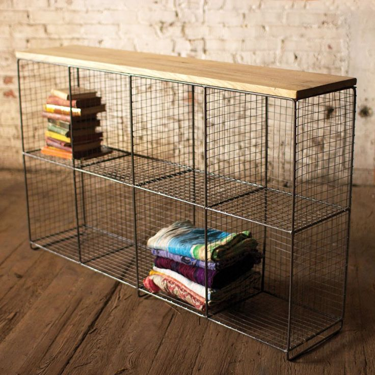Stow away the whole family's worth of shoes and bags, or make an unconventional bookshelf with this rustic console. Eight square cubby spaces made from metal wire give you a ton of organizational space, while preserving an open feel. The wood top is a smooth and sturdy surface, but it's a great platform for more delicate decor pieces as well.
