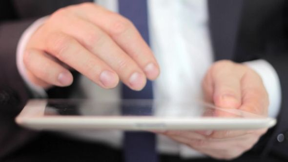 Businessman Working On Tablet