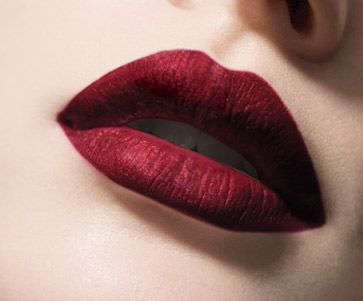 Wearing a wine/burgundy, matte lipstick this Fall? First, outline lips with a concealer stick to prevent feathering.