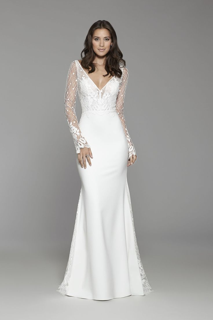 Tara Keely Bridal Style 2757 - Diamond white Crepe long sleeve sheath gown, lattice Chantilly lace bodice with floral detail, V neckline with delicate trim accent, sheer high back, lace godets accenting the skirt and chapel train.