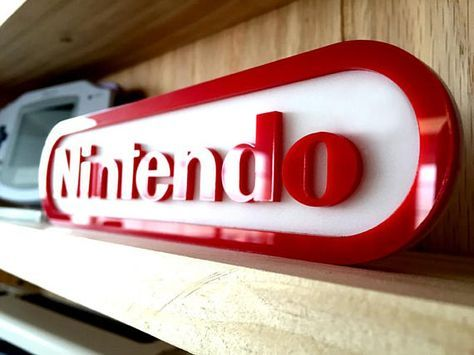 These signs are laser cut from acrylic and assembled here in shop. This display sign is themed after the Nintendo logo. Respect your collection. These…